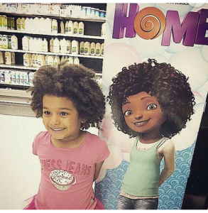 This picture warms my heart. Growing up as a black girl with natural hair, I never saw images of young girl or women that looked like me...you know that, this might end up being a separate post.